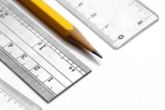 Pencil and ruler. On white Stock Images