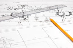 Pencil and ruler against the unpacked drawing. Pencil and a ruler is printed on the drawing Royalty Free Stock Photo