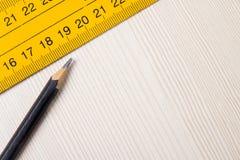 Pencil and ruler closeup on wooden Board Stock Photos