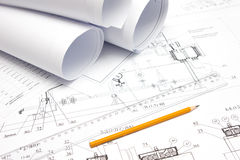 Pencil, ruler and drawings are on the table. Pencil and a ruler is printed on the drawing Royalty Free Stock Photography