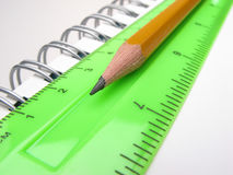 Pencil, ruler and notepad Stock Images
