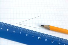 Pencil and ruler on a school writing-book. Lead pencil and blue ruler on a school writing-book royalty free stock photography