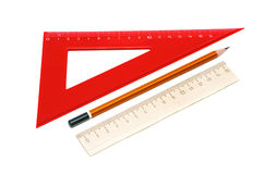 Pencil and ruler on a white background. Closeup Royalty Free Stock Photos