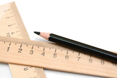 Pencil and rulers on a white background. Stock Image
