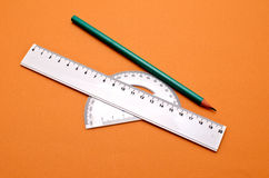 Pencil and rules. At first flat background color Stock Image