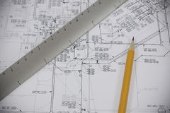 Pencil and scale on plans Royalty Free Stock Images
