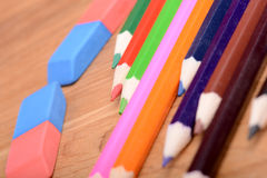 Pencil set on wooden plate with eraser Royalty Free Stock Photo