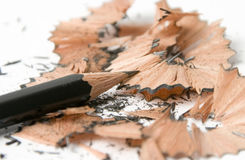 Pencil Sharp. A pencil, jsut been sharpened, with wood shavings around a clean point Royalty Free Stock Photo
