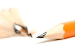 Pencil sharpened. With shaving blurred in the background. focus on tip with shallow dof Royalty Free Stock Image