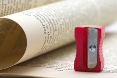 Pencil-sharpener. Pencil sharpener on opened book Stock Photography