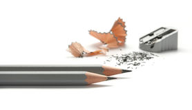 Pencil sharpener. Two pencils and sharpener on white Stock Images