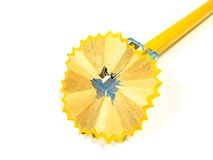 Pencil in sharpener. With cutting chip on the white background Stock Images