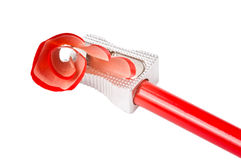 Pencil and Sharpener. A red sharp pencil being sharpened by a pencil sharpener Stock Image