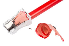 Pencil and Sharpener. A red sharp pencil being sharpened by a pencil sharpener Stock Images