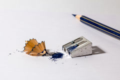 Pencil sharpener with blue pencil Stock Photography
