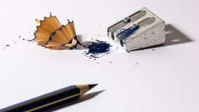 Pencil sharpener with blue pencil Stock Photos