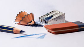 Pencil sharpener with blue pencil and a rubber Stock Photos