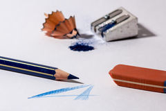 Pencil sharpener with blue pencil and a rubber Stock Images