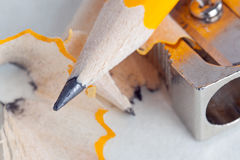 Pencil and sharpener close-up Stock Images
