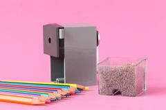 Pencil sharpener with color pencils Stock Images