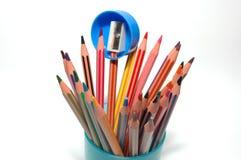 Pencil sharpener and crayons Royalty Free Stock Photo