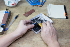 Pencil sharpener by cutter knife.  Royalty Free Stock Photo