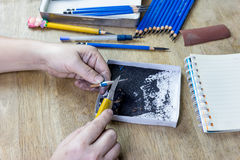 Pencil sharpener by cutter knife Royalty Free Stock Photo