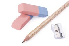 Pencil, sharpener and eraser Stock Photos