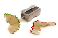Pencil Sharpener over shavings Royalty Free Stock Images