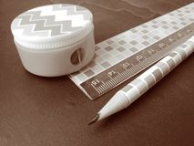 Pencil, sharpener and ruler Stock Images