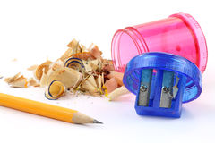 Pencil with sharpener and shavings Stock Photos