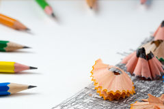 Pencil sharpener shavings on the white paper. Back to school. Copy space royalty free stock photography