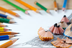 Pencil sharpener shavings on the white paper. Back to school. Copy space Royalty Free Stock Photos