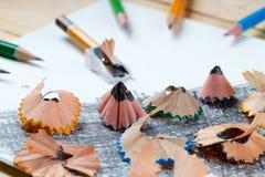 Pencil sharpener shavings on the white paper. Back to school Stock Images