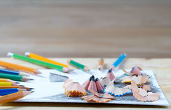 Pencil sharpener shavings on the white paper. Back to school Stock Photo