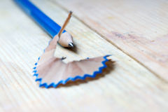 Pencil sharpener shavings on a wooden table. Back to school. Copy space royalty free stock photography