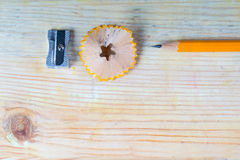 Pencil sharpener shavings on a wooden table. Back to school. Copy space royalty free stock photos