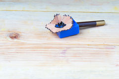 Pencil sharpener shavings on a wooden table. Back to school. Copy space stock photography