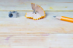 Pencil sharpener shavings on a wooden table. Back to school Royalty Free Stock Photos