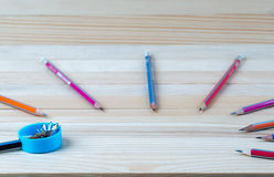 Pencil sharpener shavings on a wooden table. Back to school Stock Image