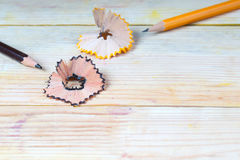 Pencil sharpener shavings on a wooden table. Back to school Stock Photography