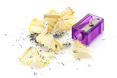 Pencil sharpener and wooden shavings Stock Photos