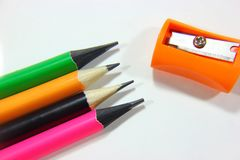 Pencil sharpeners and colored pencils in a pile. Conceptual art , colored pencils in a pile Royalty Free Stock Photos