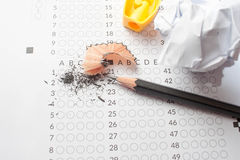 Pencil sharpeners on exam paper. Black Pencils lying on a computerized exam answer sheet Royalty Free Stock Image
