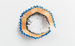 Pencil shaving bark with dust on white paper Stock Photography