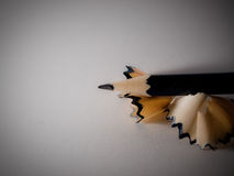 Pencil with shavings. A pencil on white paper with pencil shavings Stock Images