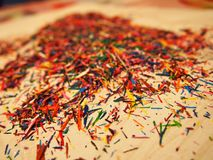 Pencil shavings. Beautiful multi-color chips from colored pencils. Details and close-up. stock photos