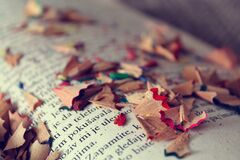Pencil shavings on book Royalty Free Stock Photo