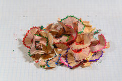 Pencil shavings. Colored pencil shavings on notebook sheet Royalty Free Stock Photos