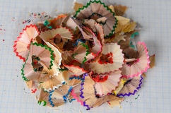 Pencil shavings. Colored pencil shavings on notebook sheet Royalty Free Stock Image